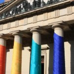 Courthouse draped in LGBTQ rainbow.