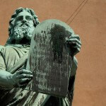 Statue of Moses bearing the 10 Commandments in a courtroom.