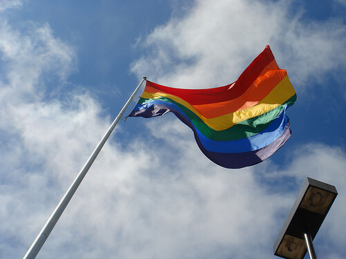 A gay rainbow flag on a flagpole