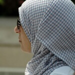 A muslim woman wearing a hijab.