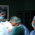 Doctors performing an abortion on a woman.
