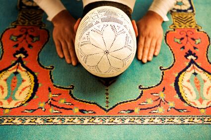 Muslim praying in Islamic fashion